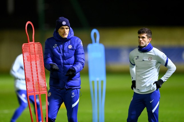 Manager Thomas Tuchel and Christian Pulisic of Chelsea during a training session at Chelsea Training Ground on January 26, 2021 in Cobham, England.