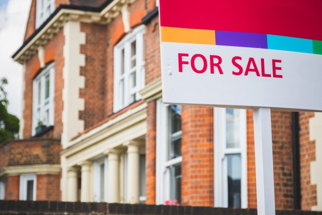 a For Sale sign displayed outside a terraced house in Crouch End, London