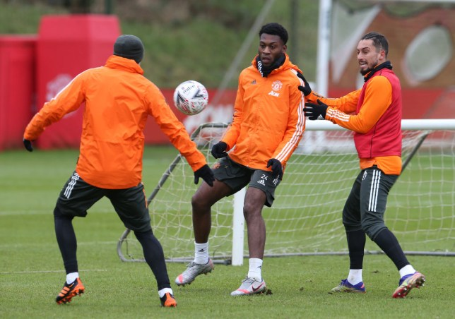 Timothy Fosu-Mensah looks on in Manchester United training