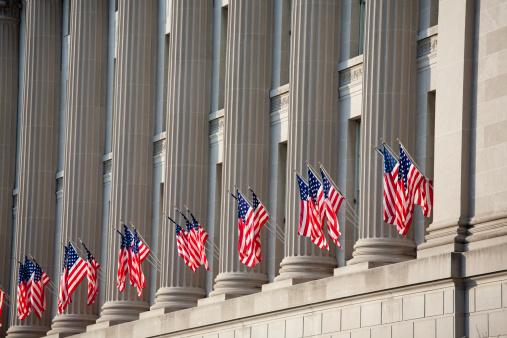 US flag decorations between columns in Washington