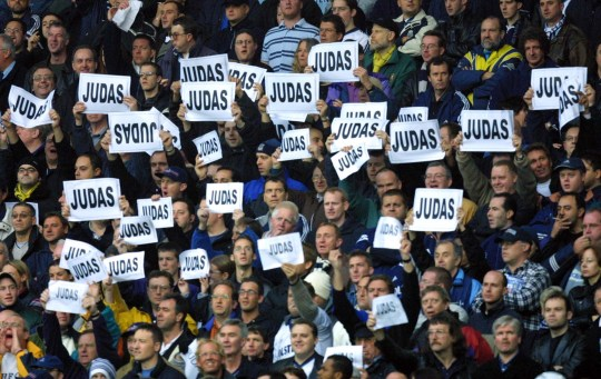 Tottenham Spurs supporters shout abuse at Arsenal's Sol Campbell