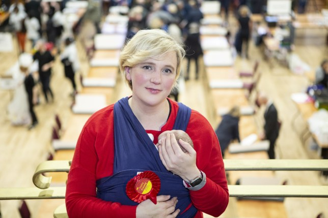 Walthamstow's Labour and Cooperative MP Stella Creasy holding her baby. Ms Creasy claims the Labour movement repeatedly told her to withdraw from leadership roles after she had her baby.