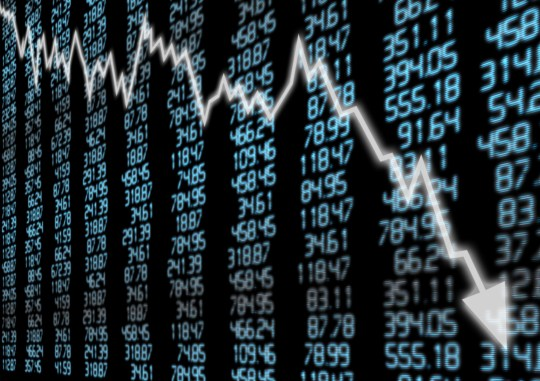 Stock Market - Arrow Graph Going Down on Blue Display; Shutterstock ID 103476707; Purchase Order: -
