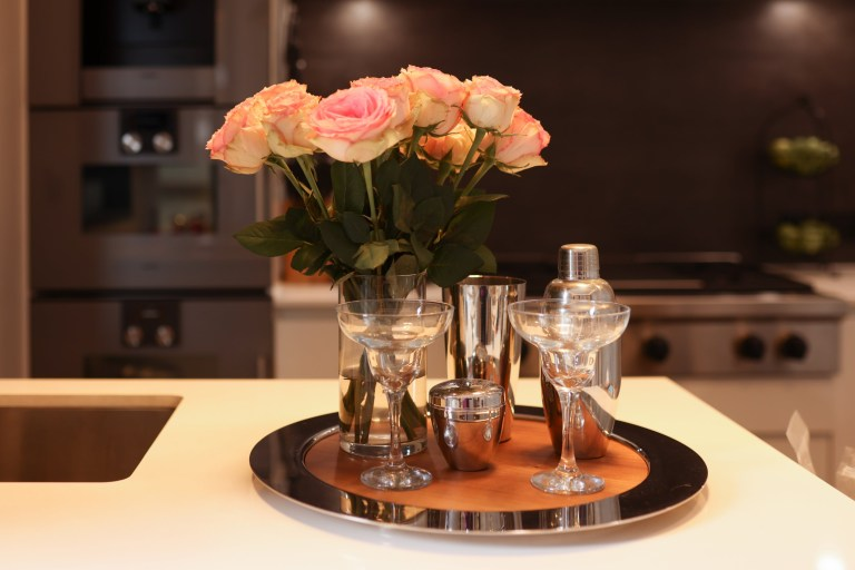 XENIA TCHOUMI'S CHELSEA HOME - roses on the counter