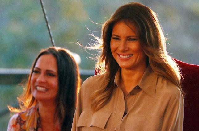 Melania Trump and her Communications Director Stephanie Grisham watch a performance of dancers at the State House in Lilongwe, Malawi, October 4, 2018. REUTERS/Carlo Allegri - RC171D4F89E0