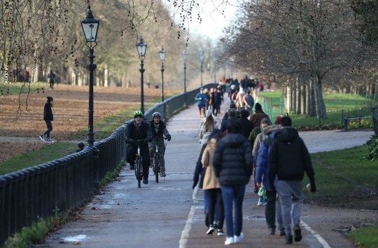People walking in Hyde Park, London. PA Photo. Picture date: Sunday December 27, 2020. Storm Bella brought severe gales and heavy rain to the UK and Ireland with winds of up to 70mph in exposed coastal locations of the UK and with heavy rainfall in Wales and south-west England. See PA story WEATHER Bella. Photo credit should read: Andrew Matthews/PA Wire