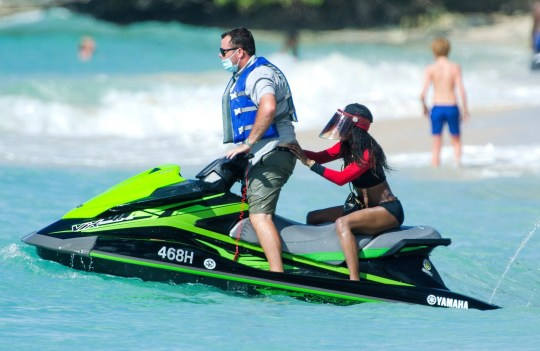 Sinitta on the back of a chauffeur driven jet ski in Barbados