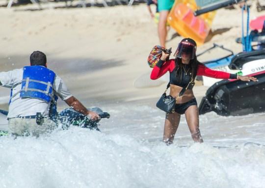 Sinitta wades towards a chauffeur driven jet ski