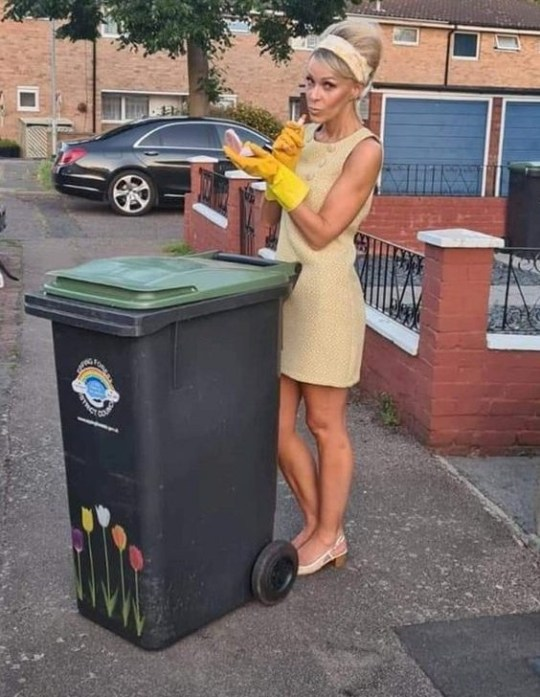 nicola matthews in a sixties style dress to take out the bins