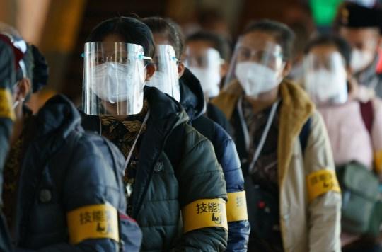 Stagiaires techniques indonésiens Nouvelles restrictions en matière d'immigration pour la nouvelle variante du COVID-19, aéroport international de Haneda, Tokyo, Japon.  Le Japon a découvert une nouvelle variante du coronavirus qui a été découverte chez des passagers arrivés à Tokyo en provenance du Brésil.