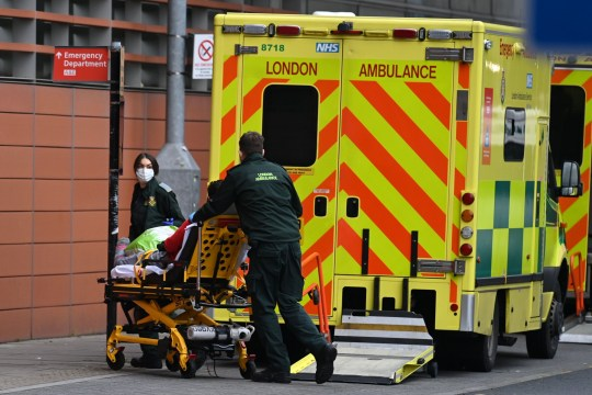 London Ambulance staff stretcher a patient from the ambulance into The Royal London Hospital in east London, on January 2, 2021. - Health Services are under increasing pressure after record levels of daily lab-confirmed cases of Covid-19 has led to more patients being treated in hospital in England than during the initial peak of the outbreak in April. (Photo by DANIEL LEAL-OLIVAS / AFP) (Photo by DANIEL LEAL-OLIVAS/AFP via Getty Images)