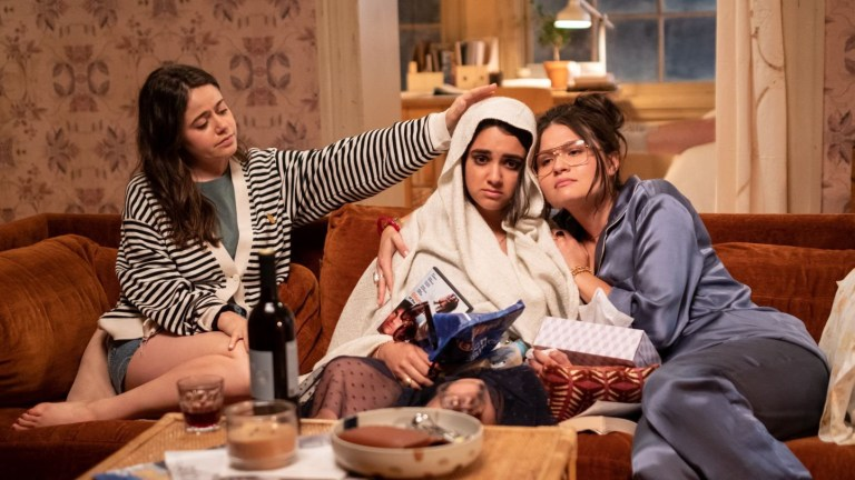 Amanda (Molly Gordon) and Nadine (Phillipa Soo) try to help Lucy (Geraldine Viswanathan, center) feel better in THE BROKEN HEARTS GALLERY.