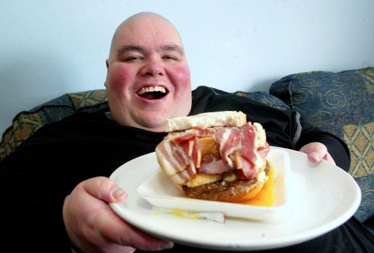 FILE PHOTO - Barry Austin. See SWNS story SWMDdead. A football fan once dubbed Britain's fattest man has died, according to the club he supported. Barry Austin died yesterday aged 52 yesterday according to Birmingham City FC's official Twitter page. Once known as Britain's fattest man his weight peaked at 65 stone.At one point he consumed up to 29,000 calories and drinking up to 12 litres of fizzy drink in a day.