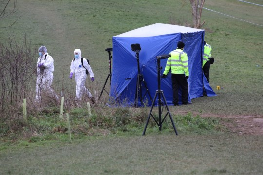 Forensic officers at the tent in Bugs Bottom field in Emmer Green, Reading, where a 13-year-old boy died after being stabbed on Sunday. PA Photo. Picture date: Monday January 4, 2021. Thames Valley Police have said five teenagers aged between 13 and 14 are being held on suspicion of conspiracy to commit murder. See PA story POLICE Reading. Photo credit should read: Jonathan Brady/PA Wire