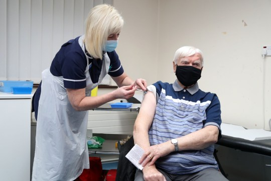 A man being given the Oxford AstraZeneca Covid vaccine