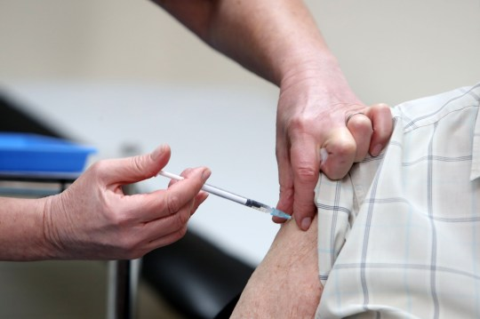 Practice Sister Tina Sutton administers a dose of the AstraZeneca/Oxford Covid-19 vaccine to a patient at the Pontcae Medical Practice in Merthyr Tydfil in south Wales on January 4, 2021. - Britain on Monday began rolling out the Oxford-AstraZeneca coronavirus vaccine, a possible game-changer in fighting the disease worldwide. (Photo by Geoff Caddick / AFP) (Photo by GEOFF CADDICK/AFP via Getty Images)