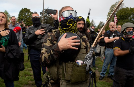 PORTLAND OREGON - SEPTEMBER 26: Members of the Proud Boys, a gang that supports President Trump, hold a rally on September 26, 2020 in Delta Park on the edge of Portland, Oregon.The city, with a large activist community, is surrounded by conservative rural areas, and the political between urban and rural areas during the 2020 Presidential elections is particularly acute in Oregon. (Photo by Andrew Lichtenstein/Corbis via Getty Images)