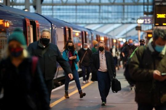 People arrive at Waterloo station during morning rush hour, amid the coronavirus disease (COVID-19) outbreak, in London, Britain, January 5, 2021. REUTERS/Hannah McKay