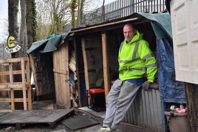 A homeless man has spent the pandemic living in a wooden cabin he built himself by the side of a major road. Chris Inker began constructing his temporary home on a small patch of land alongside the A4042 in Newport in the summer of last year. The 45-year-old said he first began collecting unwanted pallet wood and other materials simply to line the floor of a small camp he'd made. Five months later, Chris has two cabins each with its own bedroom, two generators, a sitting area with a fire pit, and a shed to store wood.