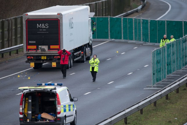 06.01.21 - Police accident investigation officers at the scene of the incident on the M4 near junction 32 at Cardiff after a pedestrian was killed after being hit by a lorry
