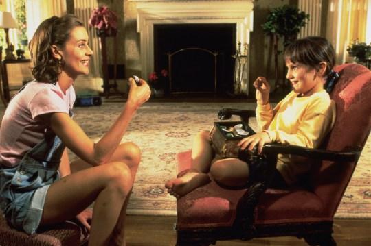 Embeth Davidtz as Miss Honey, and Mara Wilson as Matilda