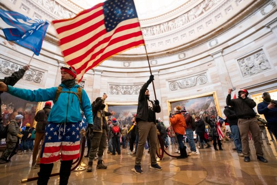 epa08923424 Supporters of US President Donald J. Trump in the Capitol Rotunda after breaching Capitol security in Washington, DC, USA, 06 January 2021. Protesters entered the US Capitol where the Electoral College vote certification for President-elect Joe Biden took place. EPA/JIM LO SCALZO Trump/BLM comparison
