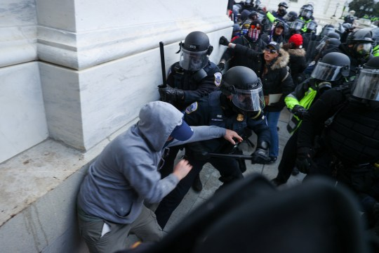 Pro Trump mobs clash with police outside Capitol Hill