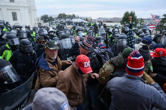 WASHINGTON D.C., USA - JANUARY 6: Security forces take measures at the entrance of US Capitol after the US President Donald Trumps supporters breached the US Capitol security in Washington D.C., United States on January 06, 2021. Pro-Trump rioters stormed the US Capitol as lawmakers were set to sign off Wednesday on President-elect Joe Biden's electoral victory in what was supposed to be a routine process headed to Inauguration Day. (Photo by Tayfun Coskun/Anadolu Agency via Getty Images)