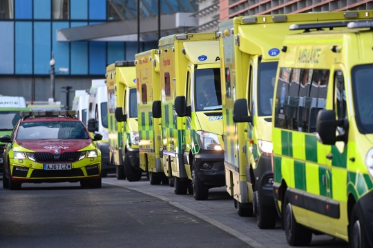 epa08924893 Ambulances line up outside the Royal London Hospital, in London, Britain, 07 January 2021. Britain's National Health Service (NHS) is coming under severe pressure as COVID-19 hospital admissions continue to rise across the United Kingdom. Some 1,000 people are dying each day from the disease. EPA/ANDY RAIN