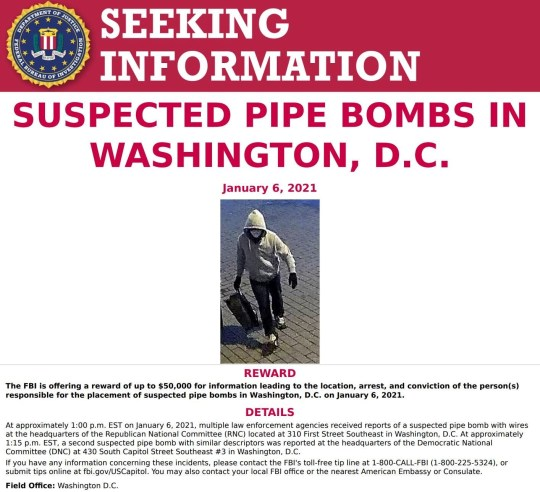 A notice requesting information on person(s) responsible for pipe bombs left at the Republican National Committee (RNC) and Democratic National Committee (DNC) headquarters features a surveillance photograph taken in Washington, U.S. January 6, 2021. FBI/Handout via REUTERS ATTENTION EDITORS - THIS IMAGE HAS BEEN SUPPLIED BY A THIRD PARTY.