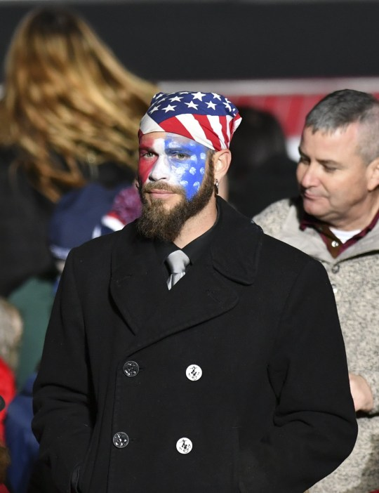 GEORGIA, USA - JANUARY 04: U.S. President Donald J. Trump's supporter Jake Angeli, known with his painted face and wearing fur and horns while storming Capitol building in Washington, is seen during a Victory Rally by the Republican National Committee in Dalton, Georgia, United States on January 04, 2021. (Photo by Peter Zay/Anadolu Agency via Getty Images)