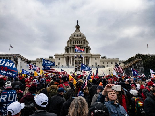 Pro-Trump supporters storm the U.S. Capitol following a rally with President Donald Trump on January 6, 2021 in Washington, DC. Trump supporters gathered in the nation's capital today to protest the ratification of President-elect Joe Biden's Electoral College victory over President Trump in the 2020 election. (Photo by Samuel Corum/Getty Images)