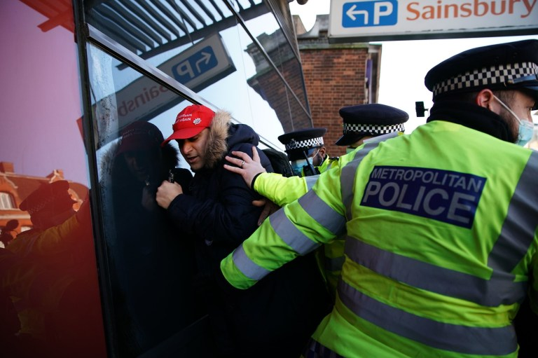 Police detain a man during an anti-lockdown protest in Clapham Common, London. PA Photo. Picture date: Saturday January 9, 2021. Photo credit should read: Aaron Chown/PA Wire