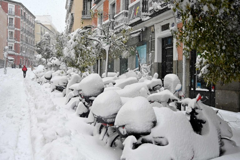 Motorcycles are covered with snow in Madrid amid a heavy snowfall on January 9, 2021. - Snowstorms across much of Spain left three people dead and caused chaos across much of the country, trapping motorists and closing the capital's air and rail links, with more falls to come. (Photo by Gabriel BOUYS / AFP) (Photo by GABRIEL BOUYS/AFP via Getty Images)