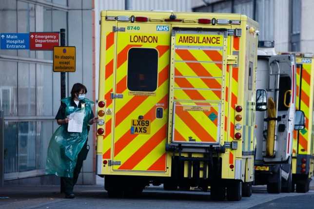 A medic wearing a PPE apron and face mask walks next to an ambulance waiting outside the emergency department of the Royal London Hospital in London, England, on January 9, 2021. Mayor of London Sadiq Khan yesterday declared a 'major incident' for the city over coronavirus pressures, warning that hospitals could soon be overwhelmed with patients with covid-19. (Photo by David Cliff/NurPhoto)