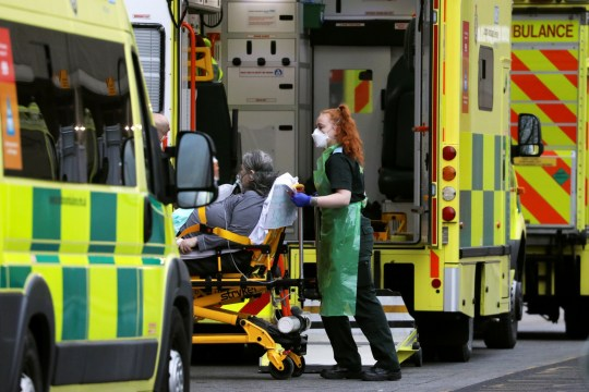 A medical worker transports a patient from an ambulance at the Royal London Hospital amidst the spread of the coronavirus disease (COVID-19) pandemic, in London, Britain, January 10, 2021.
