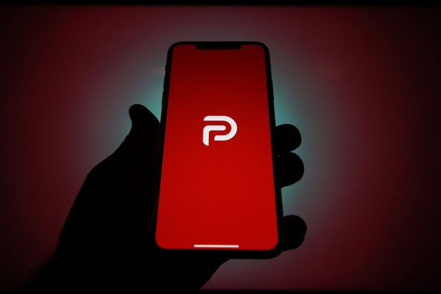 The Parler logo is seen on an Apple iPhone in this photo illustration