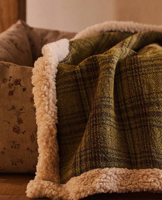 Faux shearling blanket in green check