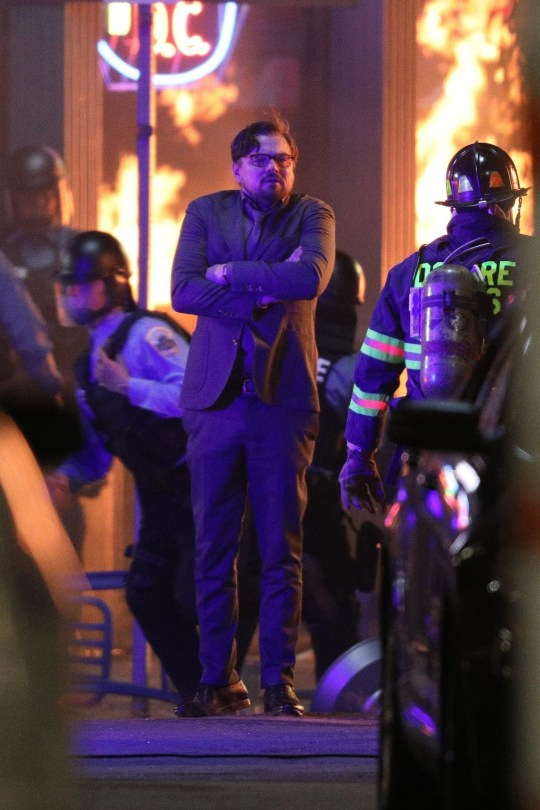 Leonardo DiCaprio surrounded by flames during Don't Look Up riot scene