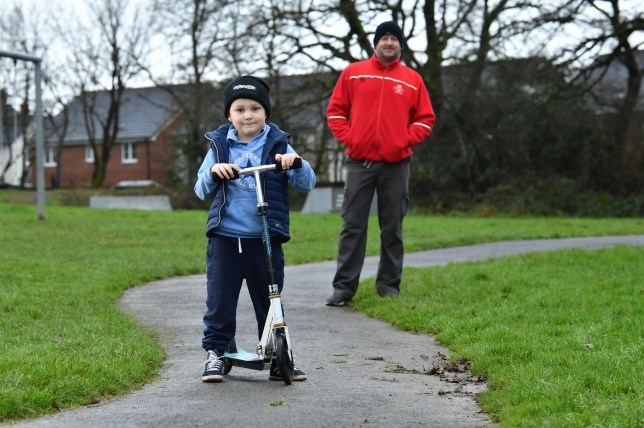 Six year-old Oliver Davies was overwhelmed when he recieved a card with some money from local postman Gavin Davies after his scooter was stolen before Christmas. Pictured are postman Gavin Davies, and Oliver Davies 6.