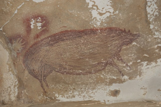 The painting of a wild pig and two hand prints dated at least 45,500 years,