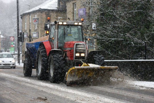 Mandatory Credit: Photo by Adam Vaughan/REX (11707403i) Holmfirth: A tractor plows and grits the road in Holmfirth, West Yorkshire. Seasonal weather, West Yorkshire, UK - 14 Jan 2021