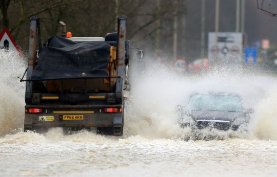 Vehicles negotiate a flooded road in Mountsorrel, Leciestershire, with a large swathe of England covered by 30 flood warnings by lunchtime Friday, and PA Photo. Picture date: Friday January 15, 2021. The Met Office said a band of heavy snow may lead to travel disruption amid a yellow weather warning for snow and ice for Scotland, northern and central England on Saturday. See PA story WEATHER Winter. Photo credit should read: Mike Egerton/PA Wire