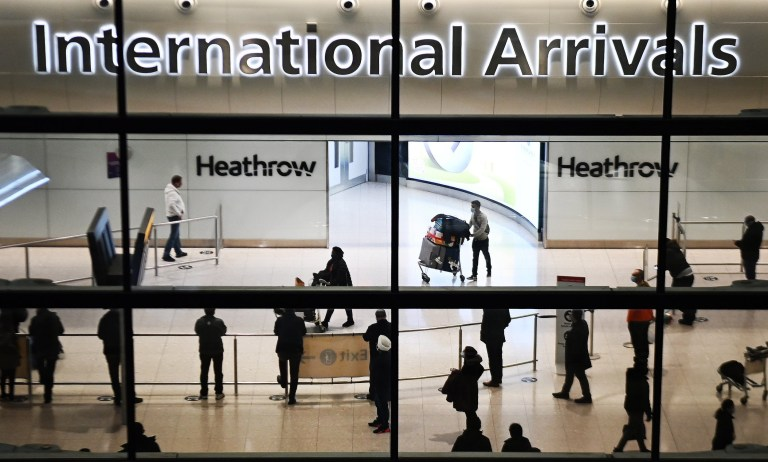 epa08941426 Travellers arrive at Heathrow Airport in London, Britain, 16 January 2021. The UK government is implementing a closure on all travel corridors from Monday 18 January 2021. Travellers will also need to provide a negative coronavirus test to enter the country. Britain's national health service (NHS) is coming under sever pressure as Covid-19 hospital admissions continue to rise across the UK. Some one thousand people are dying each day from the Covid-19 disease. EPA/ANDY RAIN