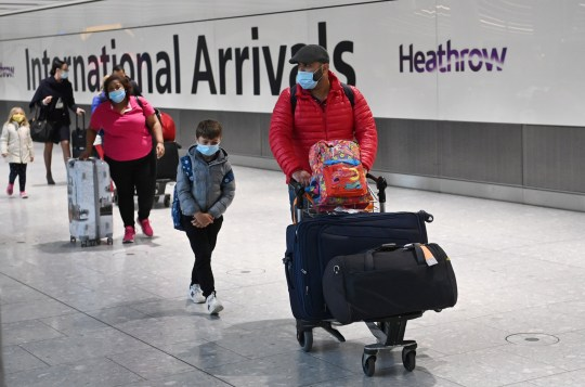 epa08945810 Travellers in the international arrival area of Heathrow Airport, near London, Britain, 18 January 2021. Travel corridors in the the UK were closed at 04:00 hours on 18 January 2021 as British government declared. Travellers arriving to England from anywhere outside the UK have to to self-isolate for 10 days and must have proof of a negative coronavirus test. Britain's national health service (NHS) is coming under sever pressure as Covid-19 hospital admissions continue to rise across the UK. EPA/NEIL HALL
