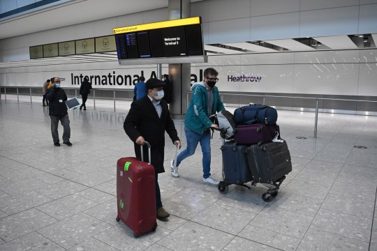 epa08945849 Travellers in the international arrival area of Heathrow Airport, near London, Britain, 18 January 2021. Travel corridors in the the UK were closed at 04:00 hours on 18 January 2021 as British government declared. Travellers arriving to England from anywhere outside the UK have to to self-isolate for 10 days and must have proof of a negative coronavirus test. Britain's national health service (NHS) is coming under sever pressure as Covid-19 hospital admissions continue to rise across the UK. EPA/NEIL HALL
