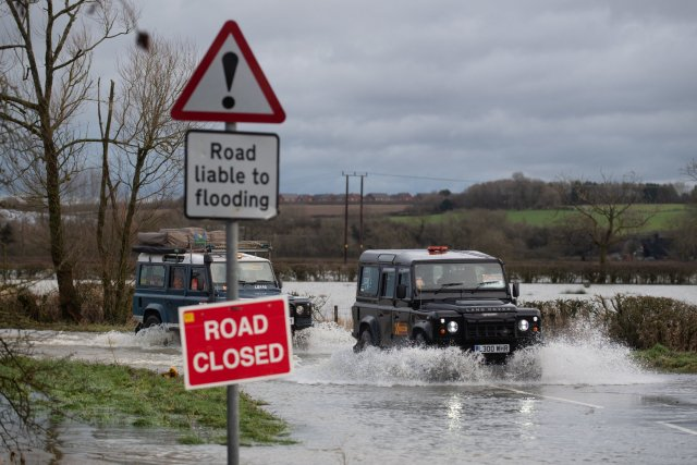 Leicestershire & Rutland 4x4 Response vehicles make their way through floodwater in Mountsorrel, Leicestershire.