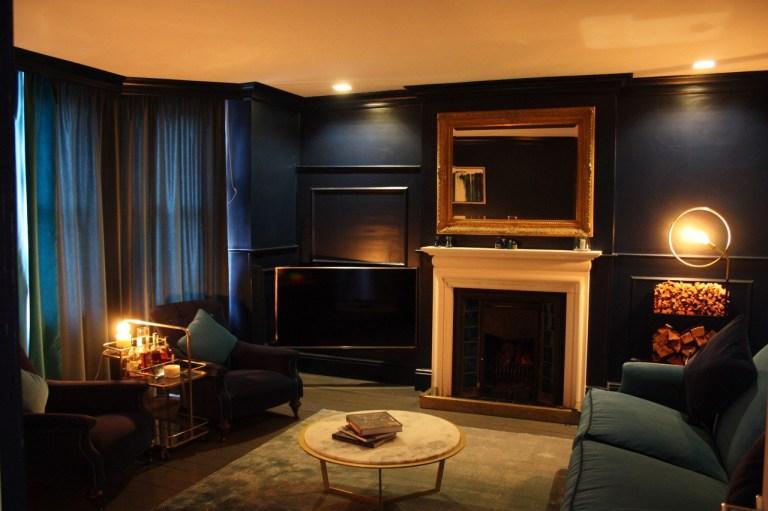 living room with hidden tv