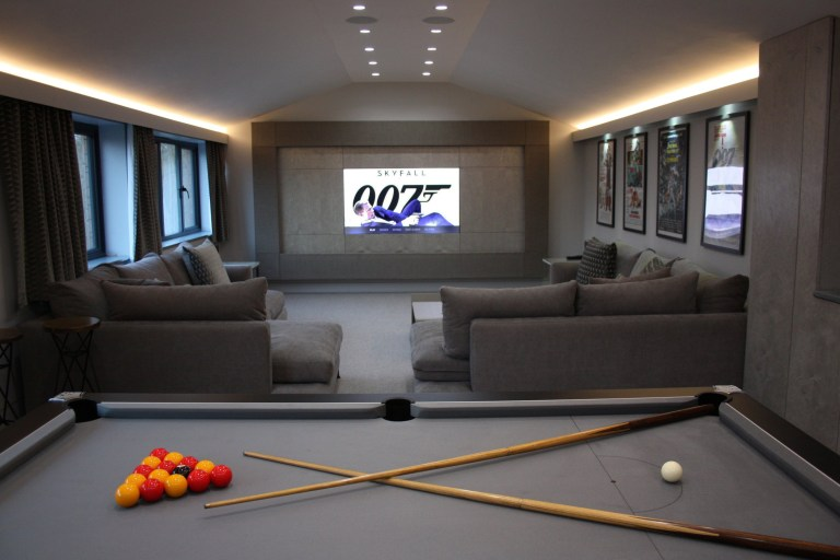 cinema and game room in hillside home