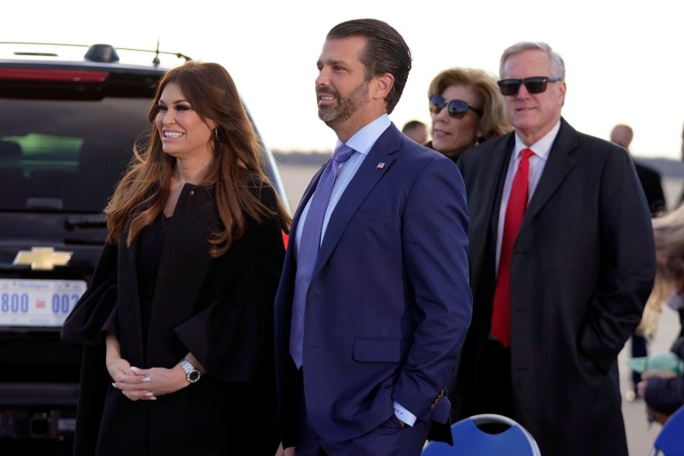 Donald Trump Jr., and his girlfriend Kimberly Guilfoyle, and White House chief of staff Mark Meadows wait for President Donald Trump and First Lady Melania Trump to arrive and board Air Force One for a final time at Andrews Air Force Base, Md., Wednesday, Jan. 20, 2021.(AP Photo/Manuel Balce Ceneta)